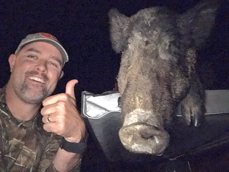 Clint Patterson with Hog - Hog Selfie