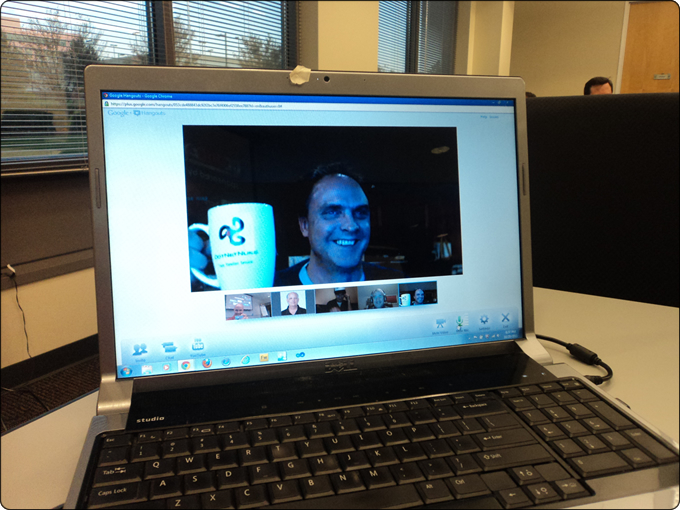 Richard English raising his DotNetNuke mug as he enjoys attending the meeting from afar